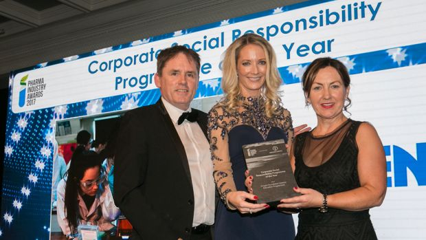 Brid O'Connell, Guaranteed Irish presents the Corporate Social Responsibility Programme of the Year award to Laoise O'Murchu & Ian Boyle, Amgen Foundation Science Education Programmes