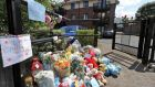 Flowers and cards placed at the entrance to the Riverside Apartments, Poddle Park, Kimmage in July. Photograph: Colin Keegan/Collins
