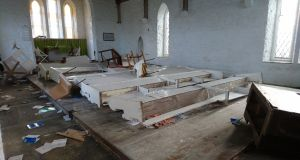 The scene of devastation at Holy Trinity Church near Clifden, Co Galway, where pews and pulpit  were turned over and smashed, electrics ripped out, and both organs turned to matchwood