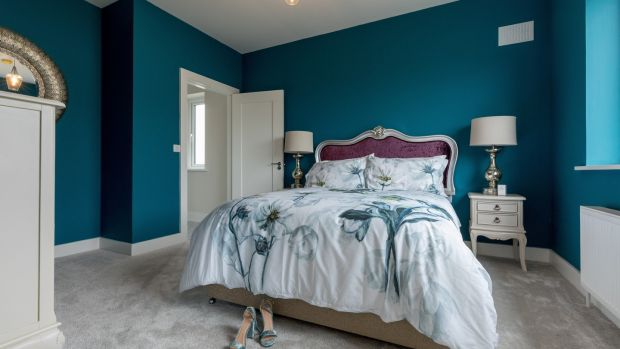 Blue guest bedroom at the Rath Ullord housing scheme in Kilkenny. Photo: Dylan Vaughan