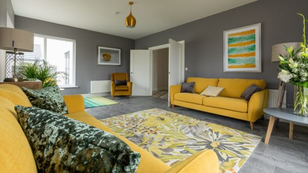 Greige livingroom with yellow tones at Rath Ullord housing scheme in Co Kilkenny.Photo: Dylan Vaughan