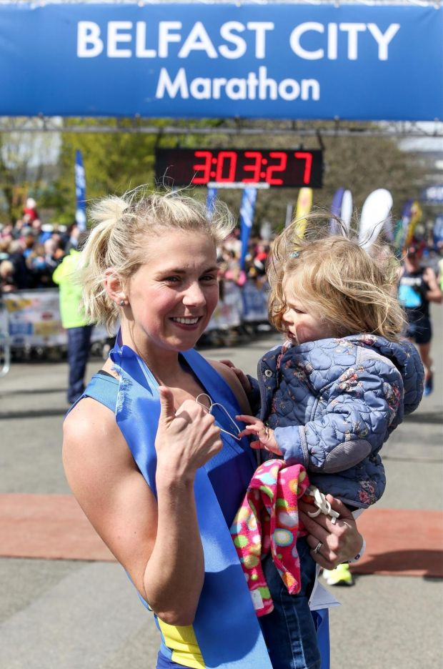 Laura Graham with her daughter Darcy after the Belfast City Marathon in 2016. Photograph: Andrew Paton/Presseye