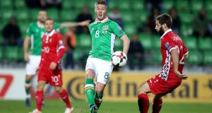Ireland midfielder James McCarthy in World Cup qualifier against Moldova last year: player has been named in Martin O'Neill's    preliminary squad for next month's  play-off against Denmark. Photograph: Ryan Byrne/Inpho