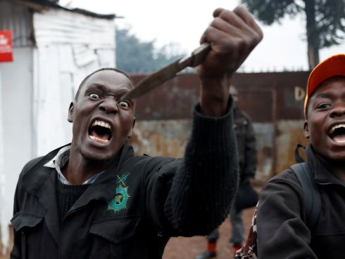 NO MESSING AROUND: An opposition supporter gestures with a knife during clashes with police in Kibera slum in Nairobi, Kenya. Photograph: Goran Tomasevic/Reuters
