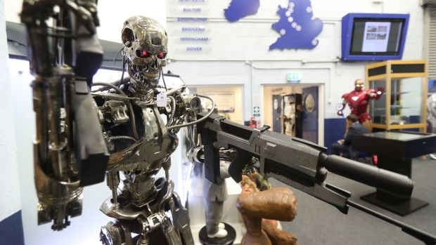 A Terminator replica stands among items seized from a drug lord which are to be auctioned at Wilsons Auctions in Mallusk, Co Antrim. Photograph: Niall Carson/PA Wire