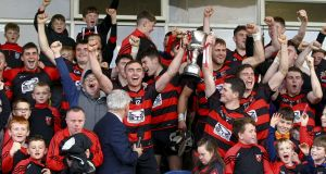 Ballygunner joint captains Pauric Mahony and Shane Walsh raise the trophy after their Waterford Senior Hurling Championship Final win over De La Salle last week. Photograph: Ken Sutton/Inpho