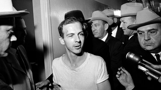 Lee Harvey Oswald talks to the media as he is led down a corridor of the Dallas police station on November 23rd, 1963 for questioning in connection with the assassination of John F Kennedy. Photograph: AP