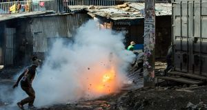 In the western city of Kisumu, police used tear gas and fired live rounds over the heads of stone-throwing youths. Photograph: Kabir Dhanji/EPA