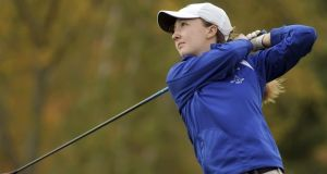 Emily Nash tees off during the Central Massachusetts Division 3 boys' golf tournament. Photograph: Christine Peterson/AP
