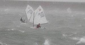 Irish youth sailing team pictured practicing during Storm Brian, Dún Laoghaire pier. Photograph:  Stephen Collins/Collins Photos