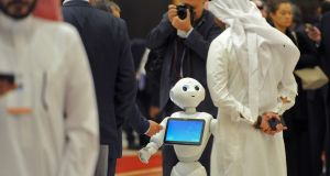 A Saudi man chats with a robot on the sidelines of the three-day Future Investment Initiatives conference in Riyadh. Photograph: AFP/Getty Images