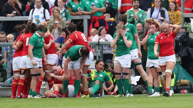 Ireland players dejected after a try for Wales during the Women's Rugby World Cup 7th place play-off at the Kingspan Stadium in Belfast. Photograph: Billy Stickland/Inpho