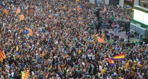 People celebrate after the approval of the declaration of  independence during a plenary session at Catalan Assembly, at Sant Jaume square in Barcelona. Photograph: Marta Perez/EPA