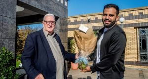 Ibrahim Halawa with Fr Seamus Fleming who made a presentation to welcome Ibrahim home after his four years in prison in Cairo.Photograph: Brenda Fitzsimons