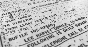 Part of a file, dated April 5th, 1964, details efforts to trace Lee Harvey Oswald's travel from Mexico City back to the United States, released for the first time on  October 26th, 2017.  Photograph: Jon Elswick/AP Photo