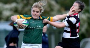 Railway Union's Cliodhna Moloney and Alex White of Old Belvedere in action. Photograph: Bryan Keane/Inpho