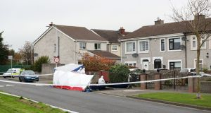 Gardaí at the scene where a 24-year-old man died after being shot early on Saturday morning, on Moatview Avenue, Coolock, north Dublin. Photograph: Niall Carson/PA Wire