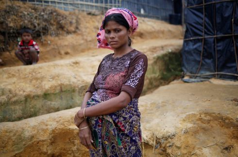 Dilder Begum (25), a Rohingya refugee who is nine months pregnant, outside her shelter at Kutupalong refugee camp near Cox's Bazar. Photograph: Adnan Abidi/Reuters
