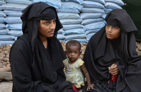 Rohingya Muslim refugees wait outside a government-run family planning centre in the Bangladeshi town of Palongkhali. Bangladesh is planning to introduce voluntary sterilisation in its overcrowded Rohingya camps, where nearly a million refugees are fighting for space, after efforts to encourage birth control failed. Photograph: Tauseef  Mustafa/AFP/Getty Images
