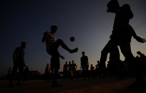 Rohingya refugees play football at sunset in Kutupalong refugee camp near Cox's Bazar.  Photograph: Hannah McKay/Reuters