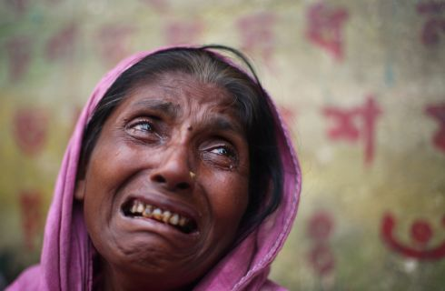 Kulsuma Begum (40), a Rohingya refugee, cries while recounting her story at Kutupalong refugee camp in Cox's Bazar. Begum said her daughter was missing and her husband and son-in-law were killed by military in Myanmar.  Photograph: Hannah McKay/Reuters