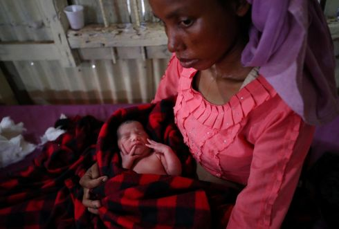Setara (30), a Rohingya refugee, holds her day-old baby while recovering from severe diarrhoea at a treatment centre in Kutupalong refugee camp. Photograph: Hannah McKay/Reuters