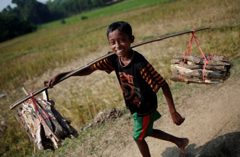 Mohammed Arif (9), a Rohingya refugee carries wood to sell it in a market at Palong Khali refugee camp near Cox's Bazar. Photograph: Adnan Abidi/Reuters