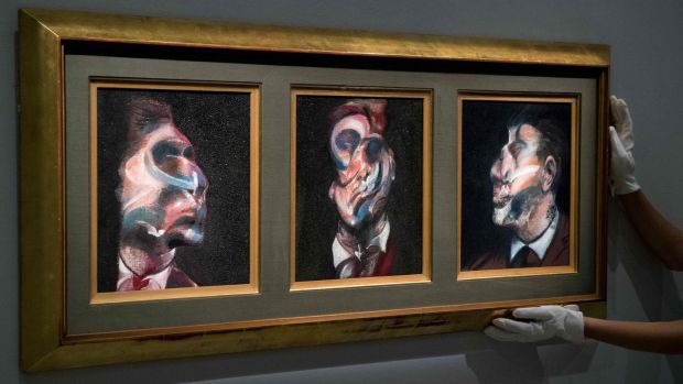 A triptych depicting George Dyer by Irish-born British artist Francis Bacon at Sotheby's auction house in London on October 25th, 2017. The triptych has not been seen in public for 50 years and is estimated to sell for $35-$45 million at auction in New York on November 16th next. Photograph: Chris J Ratcliffe/AFP/Getty Images