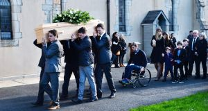 The funeral of film director Simon Fitzmaurice,  with his wife Ruth and children, family and friends, arriving at St Kilian's Church, Blacklion, Greystones, today. Photograph: Cyril Byrne/The Irish Times