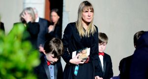 Ruth Fitzmaurice with her children at the funeral of her husband, film director Simon Fitzmaurice, at St Kilian's Church, Blacklion, Greystones, today. Photograph: Cyril Byrne/The Irish Times
