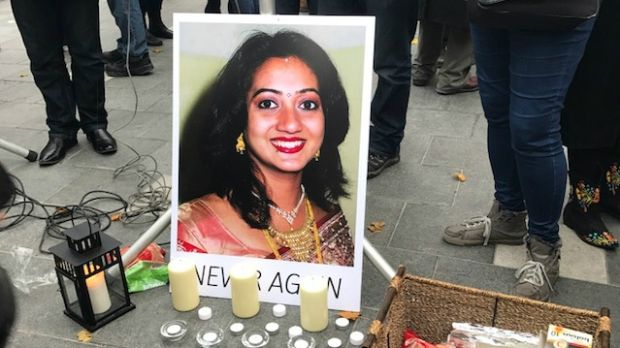 A poster of Savita Halappanavar erected on O'Connell Street, Dublin, during a vigil in her memory today. Photograph: Áine McMahon/The Irish Times