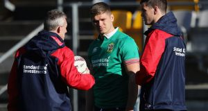 Rob Howley talks to Owen Farrell and Jonathan Sexton during the British & Irish Lions tour of New Zealand. Photo: David Rogers/Getty Images