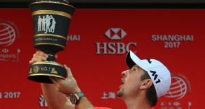 Justin Rose took advantage of a record-tying collapse by Dustin Johnson and rallied from eight shots behind to win the HSBC Champions in Shanghai. Photo: Ng Han Guan/AP Photos