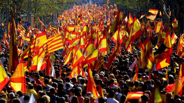 Protesters wave Spanish and Catalan Senyera flags during a pro-unity demonstration in Barcelona. Photograph: Pierre-Phillippe MarcouAFP/Getty Images