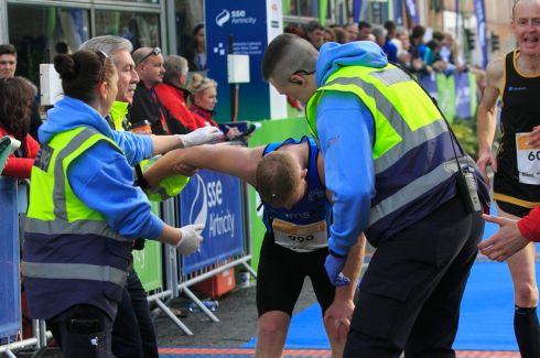 Runners on the finish line during the SSE Airtricity Marathon in Dublin's city centre. Photograph: Gareth Chaney Collins