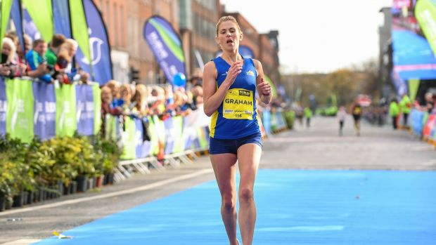 Laura Graham of Mourne Runners crosses the line to be the first Irish finisher in the women's category. Photo: Sam Barnes/Sportsfile