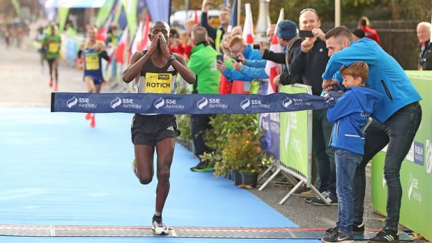 Kenya's Bernard Rotich crosses the line to win the SSE Airtricity Dublin Marathon in a time of 2:15:53. Photo: Niall Carson /PA Wire