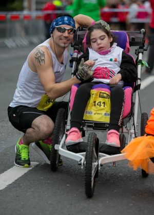 Keith Russell running with his daughter Alanna Russell (both from Navan) running for the Meadows Respite Care Home, Navan during the SSE Airtricity Marathon in Dublin. Photograph: Gareth Chaney/Collins