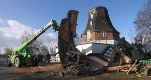 Workers remove the debris from a storm damaged wheat mill built in the year 1786  as a storm hit many parts of Germany. Photograph: Wolfgang Runge/Getty Images