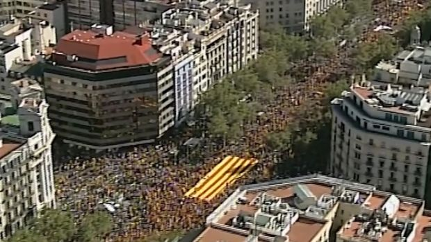 An image grab taken from a handout video released by the Spanish police shows an aerial view of protesters holding a giant Catalan flag during a pro-unity demonstration in Barcelona. Photograph: Spanish police/AFP/Getty Images