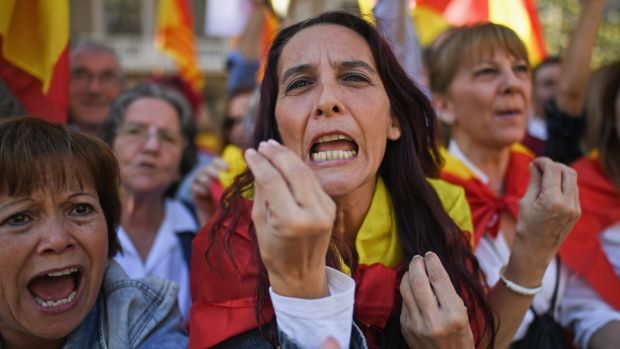 Pro-unity supporters take part in a demonstration in central Barcelona. Photograph: Jeff J Mitchell/Getty Images
