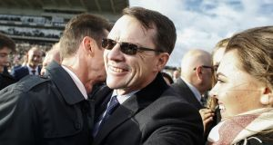 Aidan O'Brien celebrates as Saxon Warrior wins at Doncaster to secure the trainer a record 26 Group One winners in a single year. Photograph: Alan Crowhurst/Getty