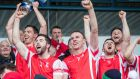 Cuala celebrate with the trophy at Parnell Park. Photograph: Oisin Keniry/Inpho