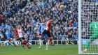 Glenn Murray leaps to head Brighton level against Southampton. Photograph: Gareth Fuller/PA