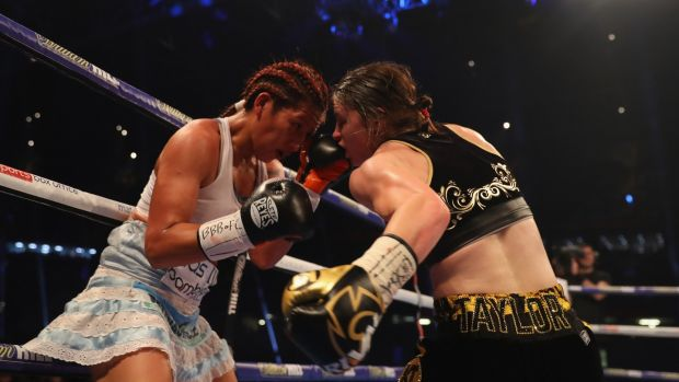 Katie Taylor and Anahi Sanchez in action during their WBA Lightweight World Championship contest . Photograph: Richard Heathcote/Getty Images