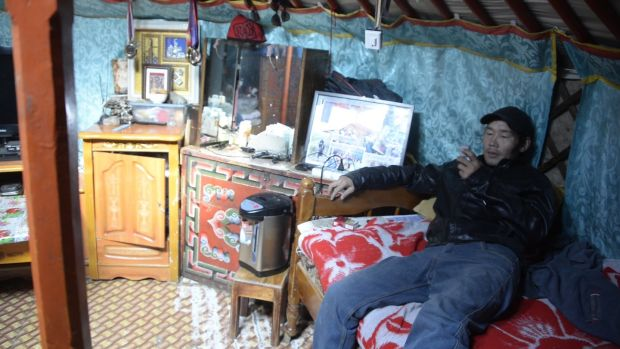 Byamba Enkhbat at home in his ger. He lost his livelihood as a nomadic farmer as his livestock 'got skinnier by day and died one after the other' in the harsh winter of 2007. Photograph: Didem Tali