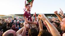 Dicksboro's Ollie Walsh celebrates after the game with the trophy. Photo: Tommy Dickson/Inpho