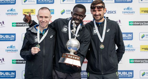 Men's national medalists at the Dublin Marathon, second-placed Gary O'Hanlon, Clonliffe Harriers A.C, race winner Freddy Sittuk of Raheny Shamrock, and third-placed Sergiu Ciobanu of Clonliffe Harriers. Photograph: Ryan Byrne/Inpho