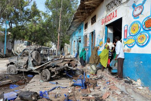 MOGADISHU BOMBING: Residents gather at the scene of a suicide car bombing at the gate of Naso Hablod Two Hotel in the Hamarweyne district of Mogadishu, Somalia. At least 23 people died in twin bomb attacks in the city on Saturday, October 28th, 2017. Photograph: Feisal Omar/Reuters