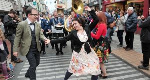 The Cork Swing Dance group with the Lamarotte Jazz Band from Holland at the The Guinness Cork Jazz Festival Parade in Cork city. Photograph:  Daragh Mc Sweeney/Provision